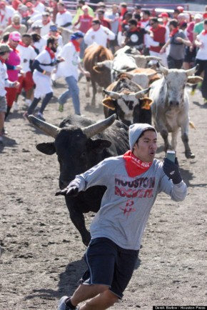 The-top-10-most-extreme-selfies-ever-taken-man-fleeing-during-running-of-the-bulls-Spain