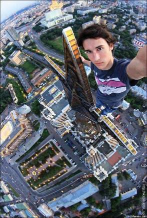 The-top-10-most-extreme-selfies-ever-taken-teen-boy-hangind-off-skyscraper-antenae